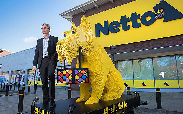 Chief executive of Netto's parent company, Dansk Supermarked, with Bright Bricks' dog made from Lego Photo: Paul Cooper